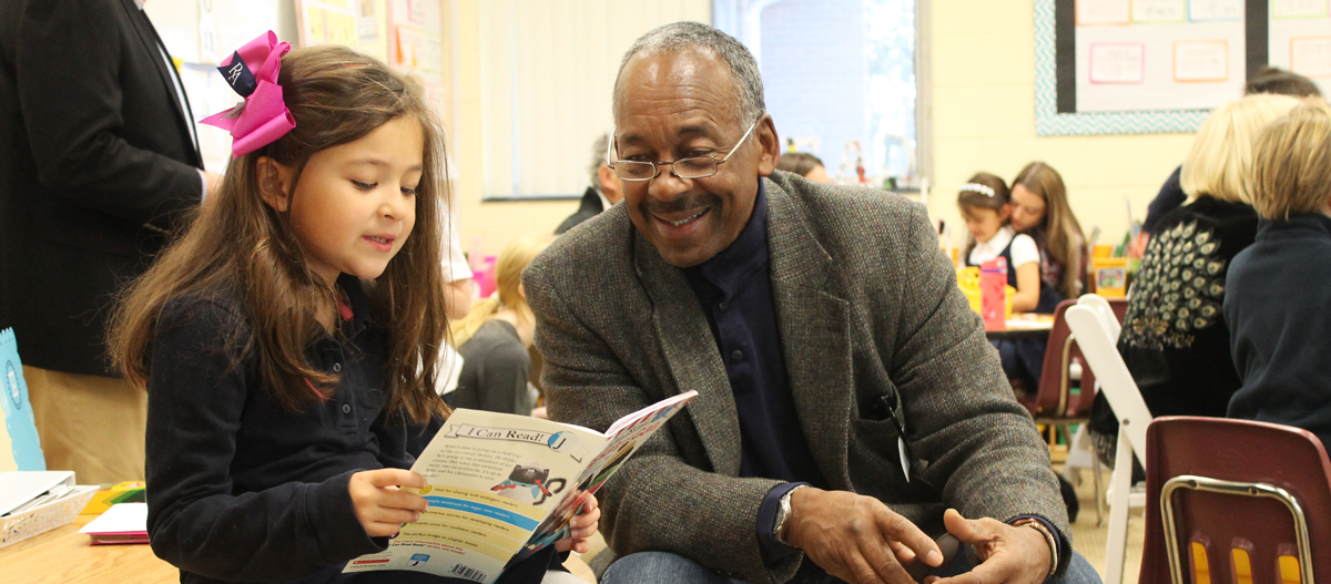 Ridgefield Academy Student Reading to Adult